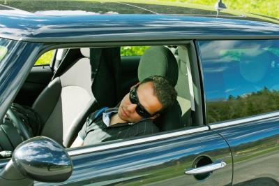 Man Sleeps In A Car, David Castillo Dominici / www.freedigitalphotos.net