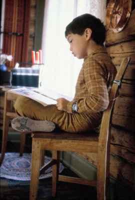 Boy reading a book - freerangestock.com